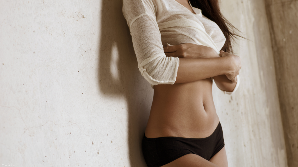 Woman considering Tummy Tuck or Liposuction in Grapevine, TX.